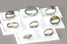 8 roman rings and 27 lead weights