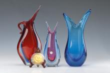 three vases and three glass medals