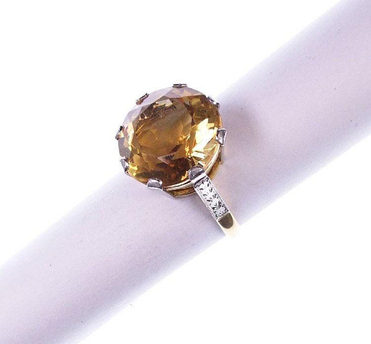 Ring mit Citrin, GG 417/000 und Platin, England um