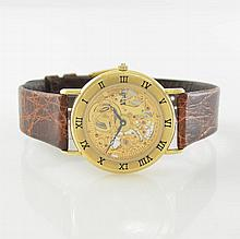 MILUS 14k yellow gold wristwatch