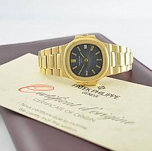 PATEK PHILIPPE 18k yellow gold gent's wristwatch Nautilus