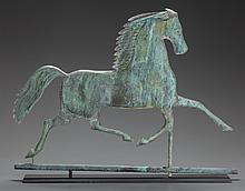 A METAL HORSE WEATHERVANE ON WOOD BASE, 20th century 21