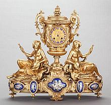 A NAPOLEON III GILT BRONZE AND ENAMELED FIGURAL CLOCK,