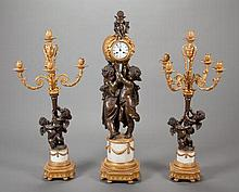 A THREE-PIECE LOUIS XVI-STYLE PATINATED AND GILT BRONZE