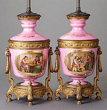 A PAIR OF LOUIS XVI-STYLE GILT BRONZE AND PORCELAIN VAS