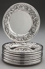 A SET OF FOURTEEN KIRK & SON SILVER BREAD AND BUTTER PL