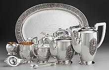 AN EIGHT PIECE THAI NAKON SILVER AND SILVER GILT TEA AN
