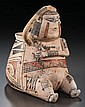 A CASAS GRANDES POLYCHROME FEMALE EFFIGY JAR c. 1200 -