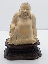 Antique Carved Ivory Chinese Japanese or Indian Buddha Maitreya Smiling Hotei Seated with Stippled Hair and Beard Statue on Wooden Plinth Base