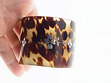 Antique Pre Ban Tortoise Shell Wide Cuff Bracelet with Silver Overlay Floral design. Very early 1900s at the latest