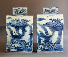 A pair of blue and white square jars