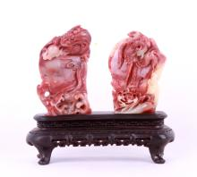 A rosequartz carving of Chinese dragon and pheonix