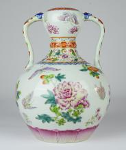 A Famille Rose Gourd Vase with Long Ears in Flowers and Butterflies Pattern