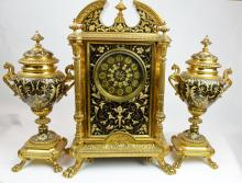 A Gild Cloisonna Clock with Two Trophies