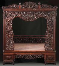 A Rosewood  Bed with  Carved Skeleton Frame