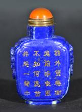 A CARVED LAPIS SNUFF BOTTLE