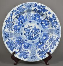 A BIG BLUE AND WHITE DISH OF FLOWERS AND BIRDS