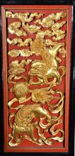 A CARVED WOOD HANGING SCREEN OF LIONS