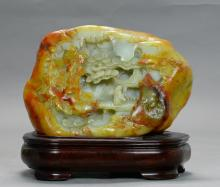 A Carved White Jade with Skin