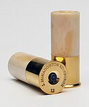 A NEW AND UNUSED PAIR OF BRASS AND HORN 12-BORE SNAP-CAPS,