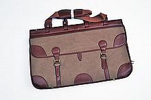 † GUARDIAN A NEW AND UNUSED MEDIUM CANVAS AND LEATHER TRAVEL BAG