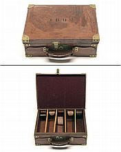 A BRASS-BOUND LEATHER CARTRIDGE MAGAZINE,
