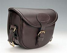 A NEW AND UNUSED HANDMADE LEATHER SUEDE-LINED MEDIUM CARTRIDGE BAG,