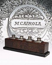 A SET OF FOUR MUFFOLINI-ENGRAVED OIL BOTTLES,