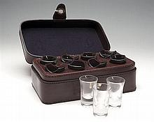 † A NEW AND UNUSED BEST QUALITY LEATHER CASED EIGHT SHOT GLASS SET,