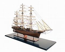 AN IMPRESSIVE, CASED WOODEN MODEL OF THE TEA CLIPPER
