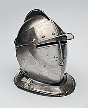 A CLOSED-FACE IRON HELMET, MOSTLY LATE 16th CENTURY,