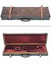 A BRASS-CORNERED OAK AND LEATHER SINGLE HAMMERGUN CASE,