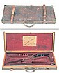 COGSWELL & HARRISON LTD. A BRASS-CORNERED OAK AND LEATHER DOUBLE GUNCASE,