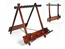 A NEW AND UNUSED TEAK PORTABLE FOLDING GUN RACK WITH LEATHER LINING AND BRASS MOUNTS,