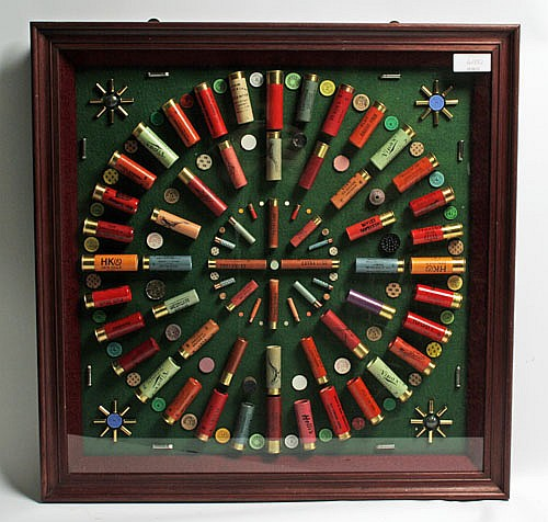 A GLAZED AND FRAMED MODERN CARTRIDGE DISPLAY BOARD,