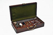 † A NEW AND UNUSED PRESENTATION CASED DELUXE 12-BORE CLEANING KIT,
