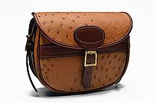 LEGGETS AN OSTRICH LEATHER SUEDE-LINED CARTRIDGE BAG,