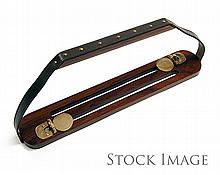 † JAMES PURDEY & SONS LTD. A NEW AND UNUSED ROSEWOOD AND LEATHER GAME CARRIER,
