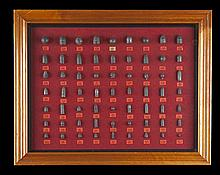 AN INTERESTING FRAMED AND GLAZED LEAD BULLET DISPLAY BOARD,