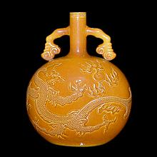 醬釉浮雕龍紋如意綬帶耳抱月瓶 Amber-Glazed Moon Flask Carved with Dragons Chasing Flaming Pearls with Ruyi Loop Handles