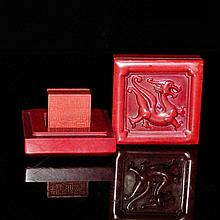 雞血石方印章連上雕螭龍蓋盒 A Square Jixue Stone Seal Inside a Chi Dragon Relief Carved Circular Box with Cover
