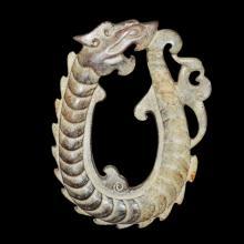 周 玉雕龙凤节纹瑗 Zhou, A Rare Jade Dragon-Phoenix Juan