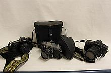 Collection of vintage Cameras and Binoculars to include Canon