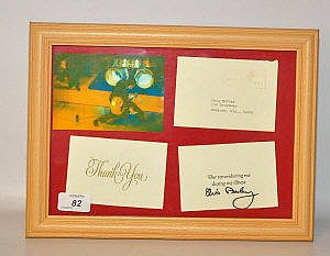 A FRAMED LETTER AND ENVELOPE BEARING SIGNATURE