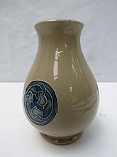 A small Moorcroft vase with flamminian design.