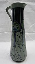 A Moorcroft trial tall jug with peacock feather