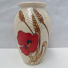 A Moorcroft vase with harvest poppy design.