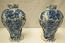 A pair of hand painted Delft 18thC octagonal vases