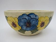A Walter Moorcroft oval vase with pansy nouveau
