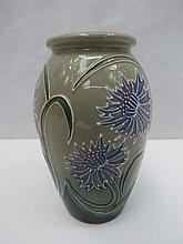 A small Moorcroft vase decorated with blue